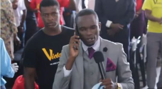 Watch! Pastor Claims To Be 'On The Phone With God' During Church Service