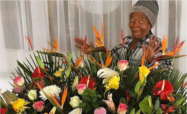 Wow! Somizi Spoils His Mom With A Dozen Of Flowers For Mother's Day
