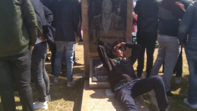 Photo of Black Twitter Reacts To Man Caught Sleeping On Simba Mhere's Grave During ProKid's Funeral